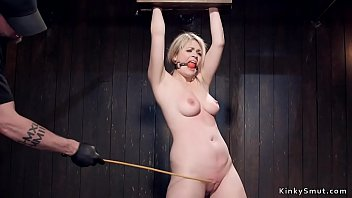 Busty blonde is caned in bondage 5 min