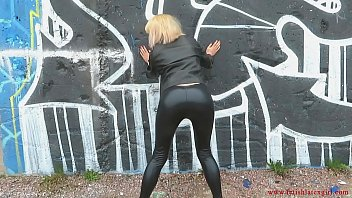 Sexy girl in a leather jacket and leggings shows her ass