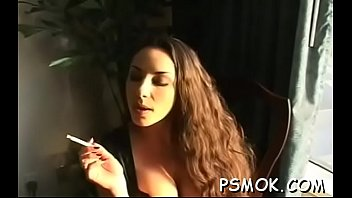 Busty babe playing with ballons whilst taking a smoke