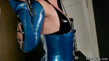 Milf and male slave in shiny latex outfit