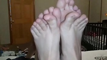 Mom and Aunt teasing son with feet and toes