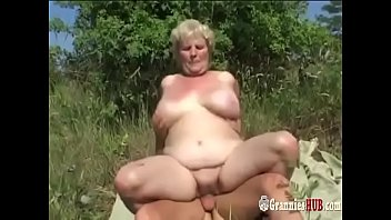 Chubby and mature Chubby granny blonde with huge tits and her young lover fuck outdoor