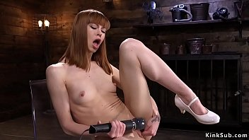 Skinny redhead riding fucking machines