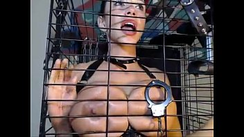 Busty Babe Blowjob in Cage - more at exquisitecamgirls.com