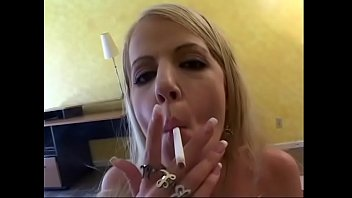 Blonde chick with perky tits Anita Blue prefers to pull her friend's pudding and smoke a cigarette at one time