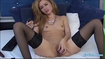 Petite Blonde Plays with a Small Dildo