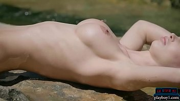 Blonde beauty with big tits strips naked in the outdoor