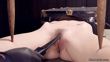 Blonde in extreme bondage toyed
