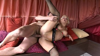 Hot blonde MILF Britney sucks on two thick cocks at once in threesome