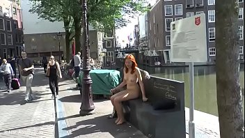 Pretty redhead walking naked in Amsterdam