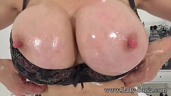 Big tits lady sonia - British milf sonia oils her big tits and plays