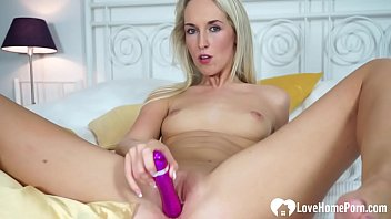 Amazing blonde babe uses her favorite toy
