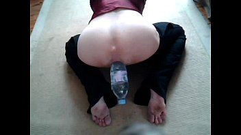 Anal plug play with a bottle