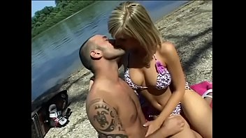 Hot blonde sucks dude's cock on the beach after water skiing