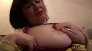 Busty mature Janey shows off her big tits and hairy pussy