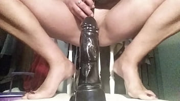 Sinbin riding her big black dildo