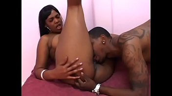 Tattooed black stud fucks big ass black slut's shaved pussy
