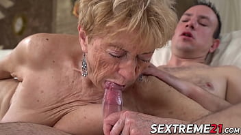 Old granny is fucked by young stud and eats his cum