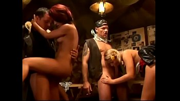 Some horny sluts are having a hardcore orgy with some studs at a pub