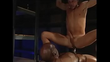 Hunk rammed by black cock