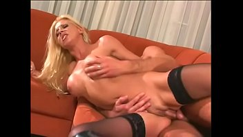 Fake boobs blonde Amber in black high heels rides schlong