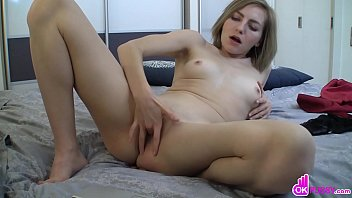 Dazzling blonde fingers her soft pussy