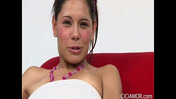 Latina sensation Cici Amor dildo fucks her wet pussy on a red chair