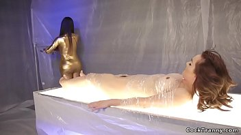 Shemale dom in golden suit fucks babe