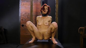 Redhead slut struggling with torture