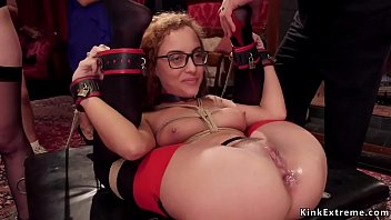 Tied slaves sharing dick at bdsm party