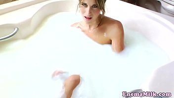 Milkenema lesbian squirting in the tub