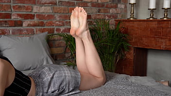 Sexy Girl In The Pose Shows Her Smelly Wrinkled Soles And Pretty Feet