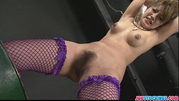 Kinky babe in fishnet stockings tied and fondled with sex toys