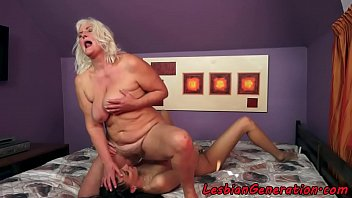 Busty grandma scissoring with younger babe