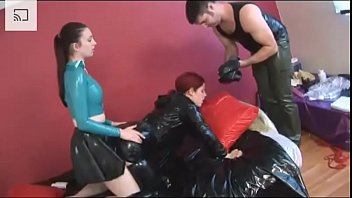 Slave gets fucked in a heavy latex and breathplay