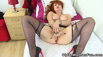 Mature Red puts her fingers to work on her clit