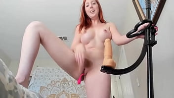 Hot redhead rides doll and pole dildo