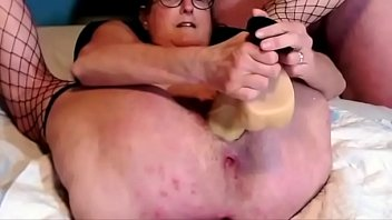 Granny With Shaved Pussy Masturbates With Huge Dildo Squirts