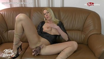 Live with a dressed milf who puts her dildo in her vagina