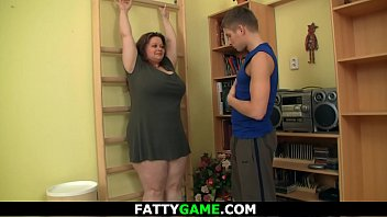 Busty plumper seduces fitness trainer