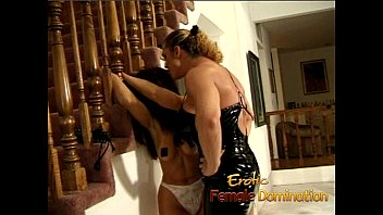 Muscly dominatrix takes it out on a hot brunette at home-6