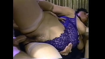Several horny guys drill all holes of an experienced brunette in the living room with their hard cocks