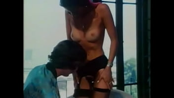 Nasty exotical hottie Linda Wong is enthralled with getting her hairy pussy stretched with huge pecker of John Holmes; she also likes to feel drops of his jizz trickle from her face after fucking