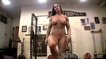 Nude muscles - Nude woman bodybuilder poses in the gym