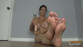 Busty Cock Stroking MILF Charlee Chase Wants You To Smell Her Big Feet