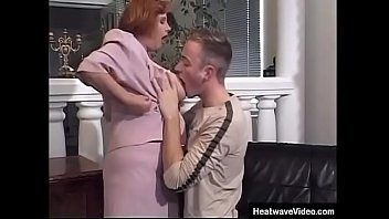 Granny is surprised when a much y. stud grabs her tits without no warning whatsoever and lasciviously sucks one of her big nipples!