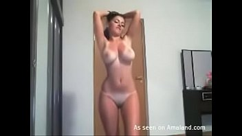 Latina chick strips and dances in front of her webcam