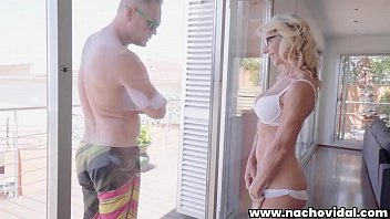 Marina admires Nacho Vidal's huge cock through the glass balcony door, stroking her pussy. She can't resist kneeling and swallowing the giant Spanish penis.