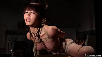 Bound Asian slave butt plugged