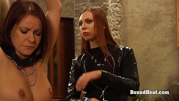 Dominant Lesbian Mistress In Leather Punishing Two Slaves With Whip